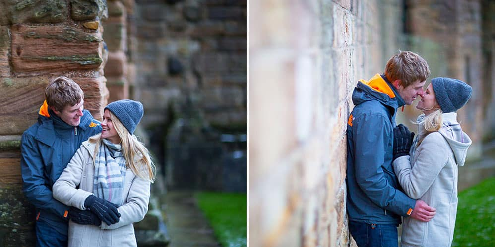 Dunfermline engagement photography happy couple next to wall