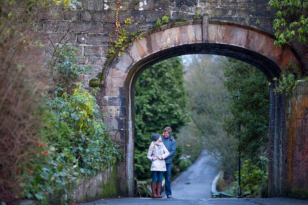 Dunfermline engagement photography couple under bridge in Dunfermline Pittencrieff Park