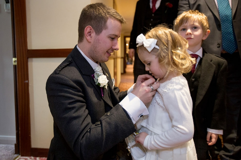 3 groom with flower girl