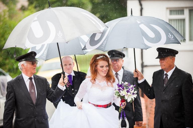 bride arrival in rain
