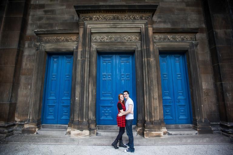 beautifull couple next to blue door
