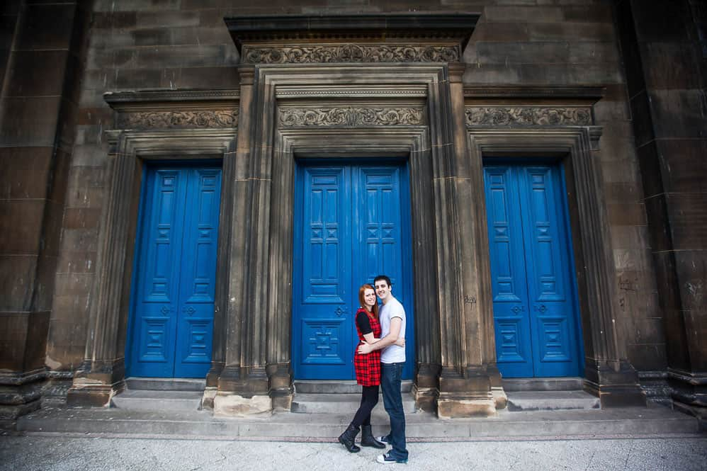 beautifull couple next to blue door