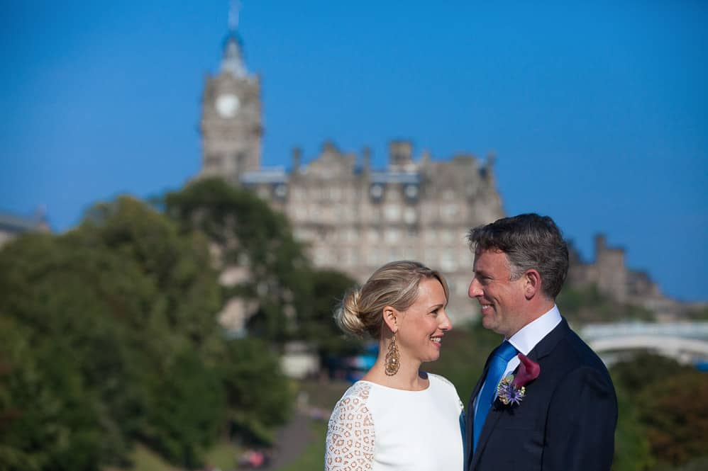 bride and groom with balmoral hotel in Edinburgh