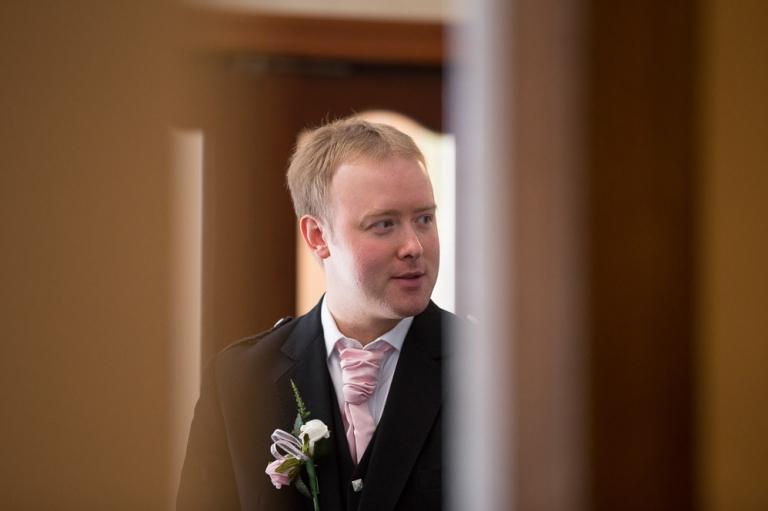 3 groom behind door