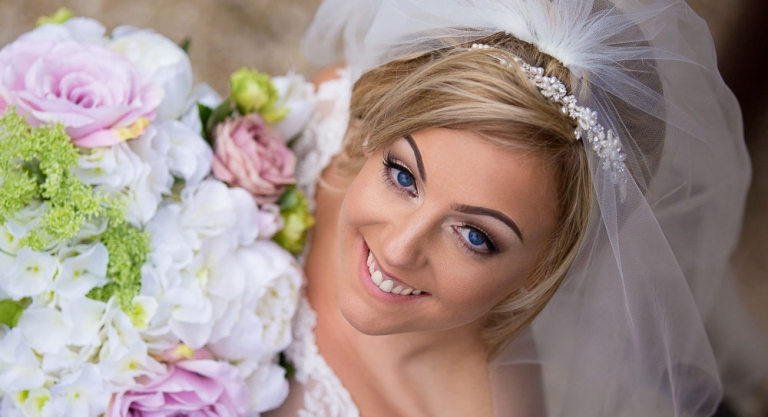 Client Gallery - bride with flowers - Edinburgh wedding photographer White Tree photography