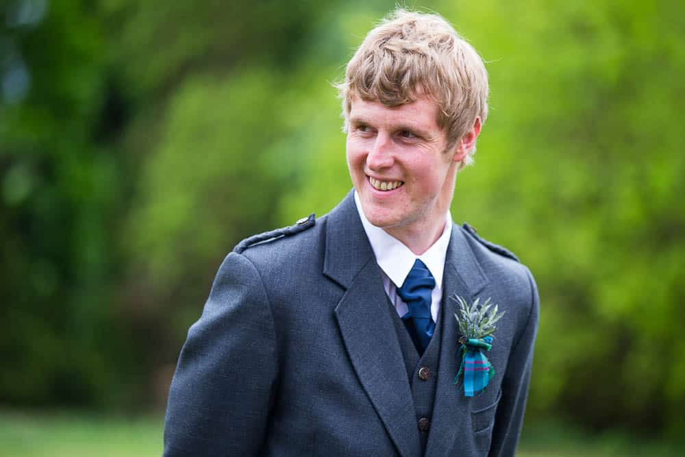 Fernie Castle wedding groom with green background
