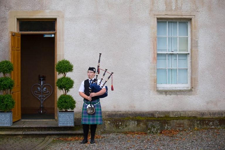 Callendar House photographer piper in front of the building Falkirk