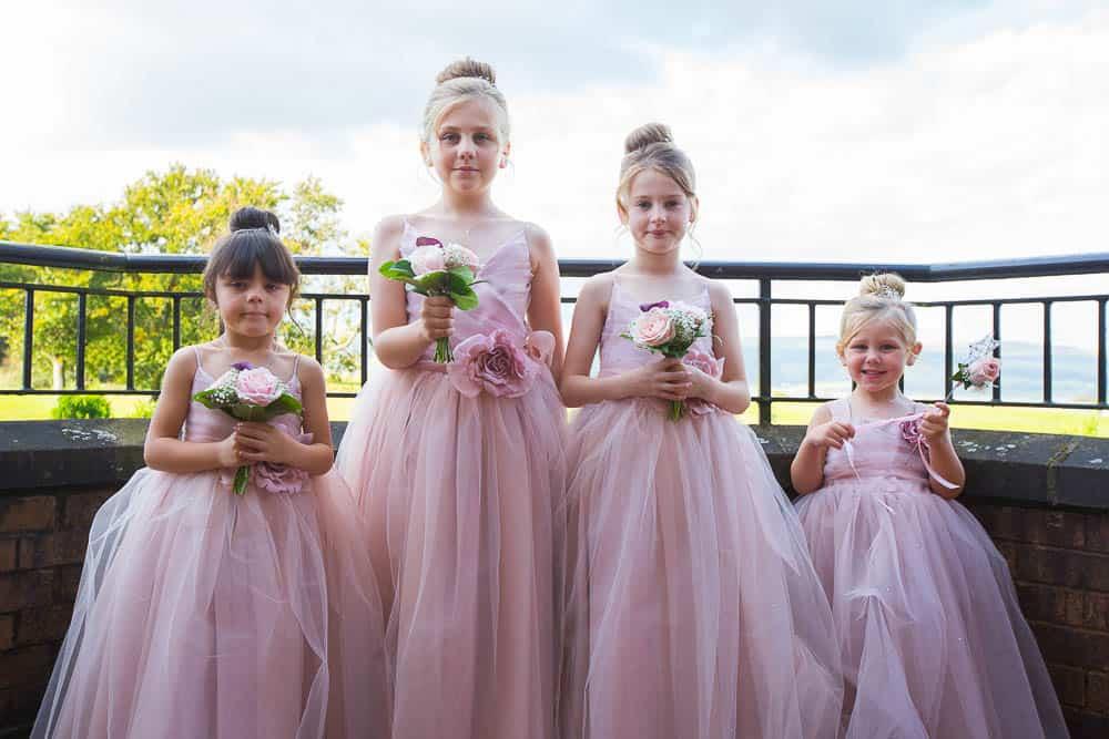 wedding photography westerwood hotel - flower girls on balcony