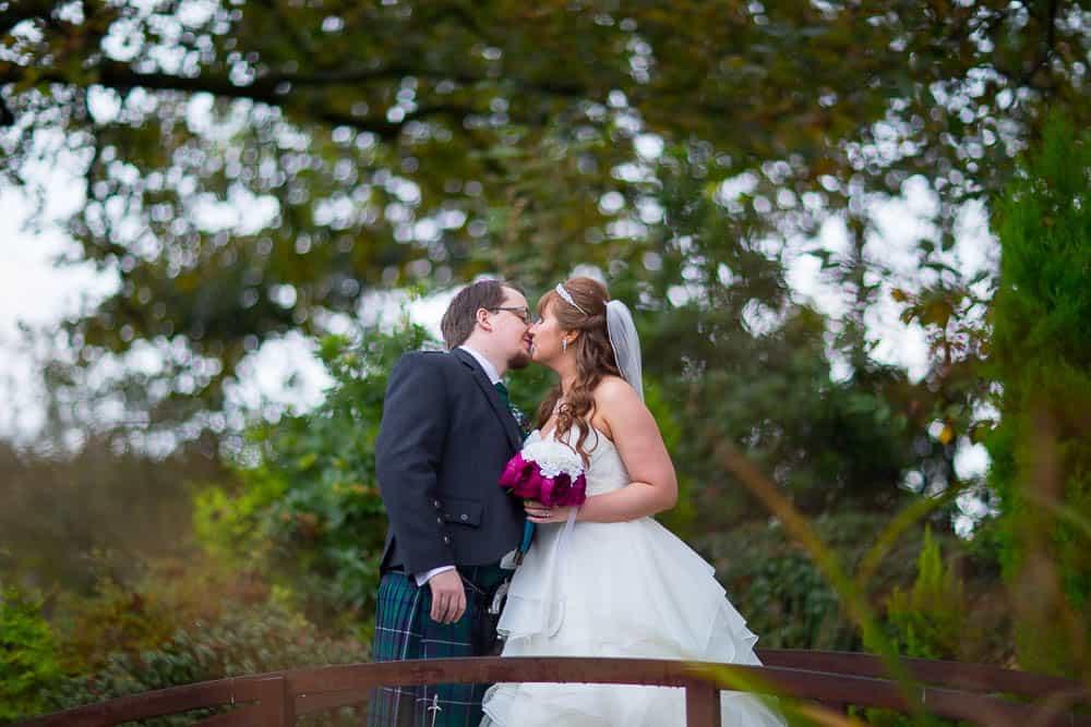 glazert country house wedding - bride and groom on bridge