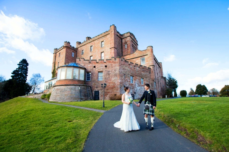 bride and groom next to Dalhousie Castle - wedding photography