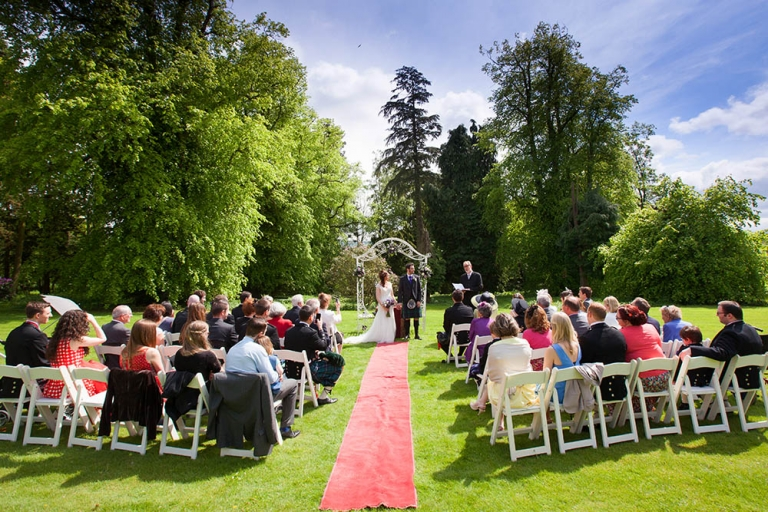 Fernie Castle wedding ceremony outdoor in the garden wide angle photograph