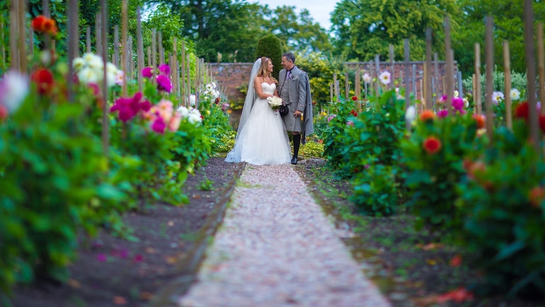 wedding photographer Edinburgh White Tree Photography bride and groom in flower garden