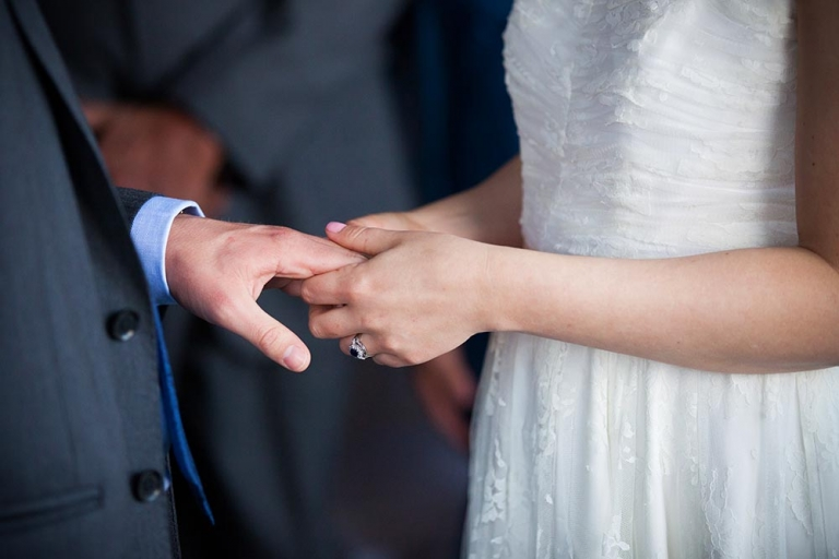closeup bride holding groom's hand south queensferry registrar's office - by white tree photography
