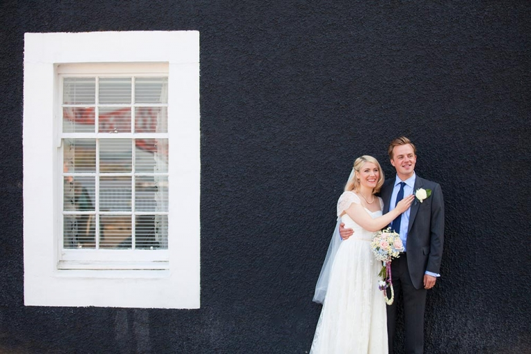 bride and groom on street south queensferry registrar's office - by white tree photography