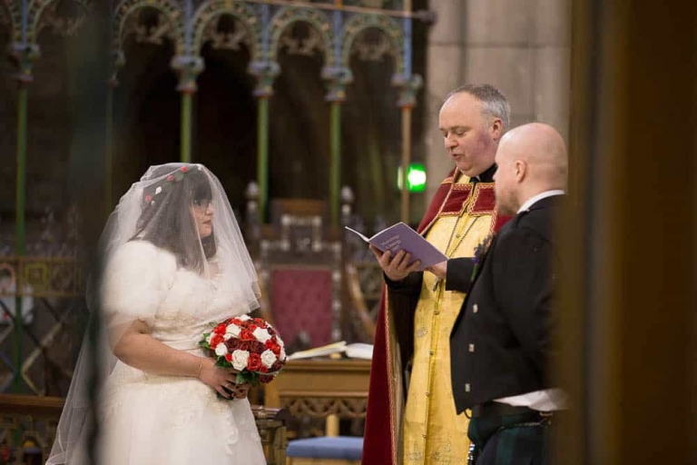 St Mary's Cathedral wedding Edinburgh couple with priest photographer