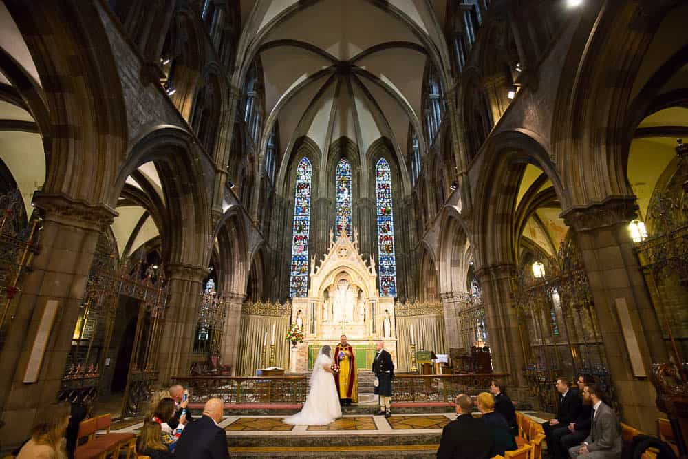 St Mary's Cathedral wedding Edinburgh couple at alter photographer pro