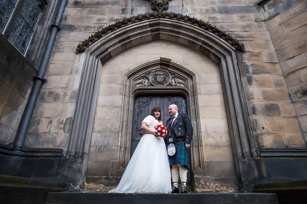 Edinburgh wedding photographer couple in front of st mary's cathedral