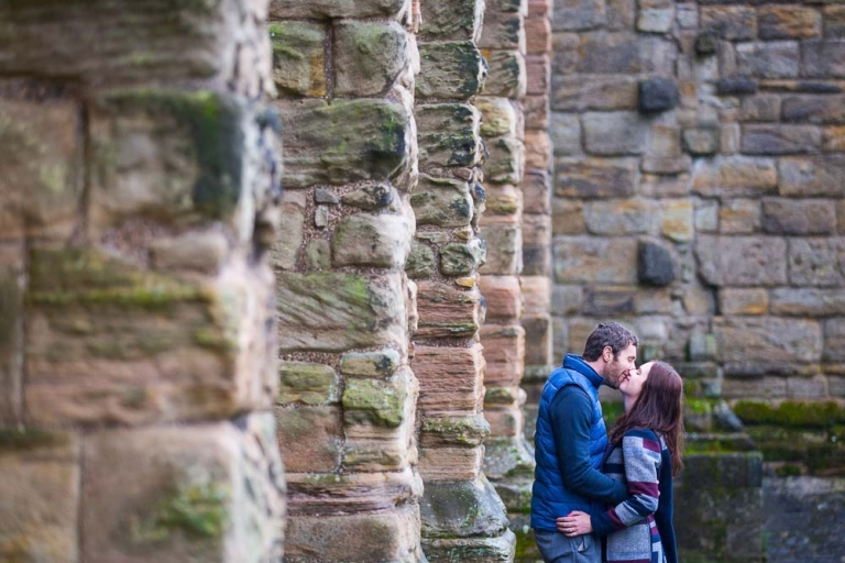 Engagement photography fife couple kissing Dunfermline Pittencreiff Park - photographed by White Tree Photography