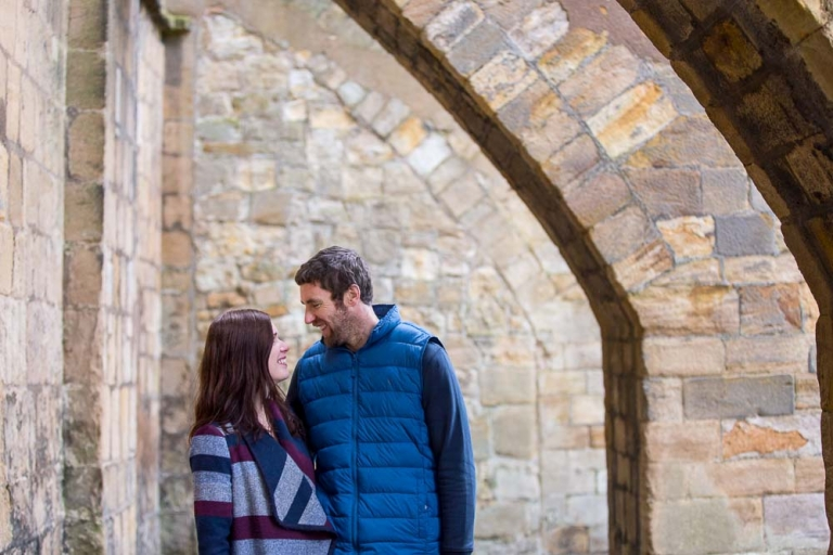 Engagement photography fife couple with architecture background Dunfermline Pittencreiff Park- photo by White Tree Photography
