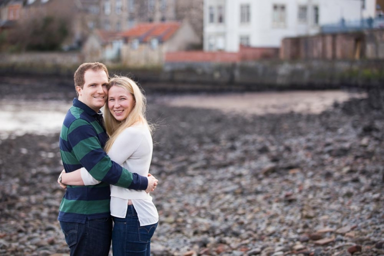 engagement photographer Edinburgh, couple on South Queensferry beach