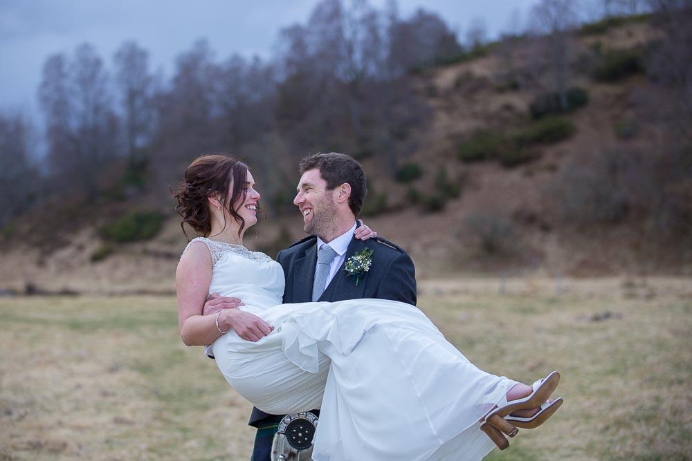 highland wedding photographer, groom holds bride