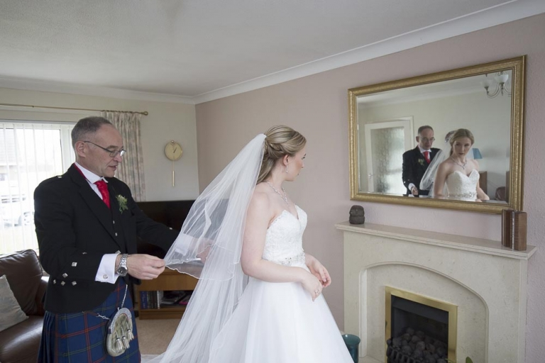 brig o doon wedding photographer father helps bride with veil