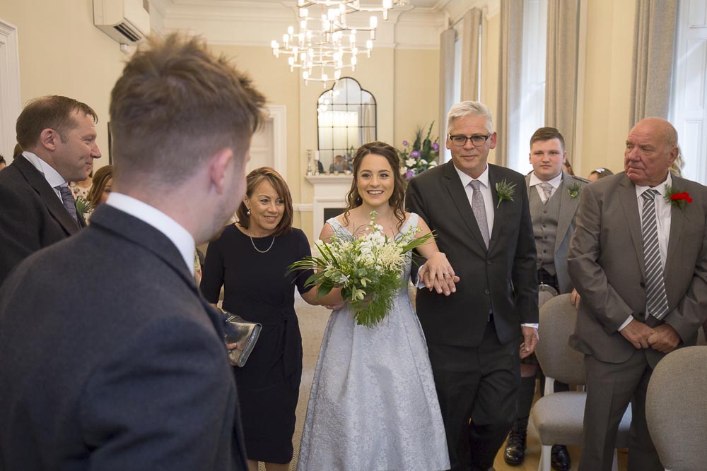 Glasgow City Chambers wedding photographer - bride walking dawn the aisle with her mother and father