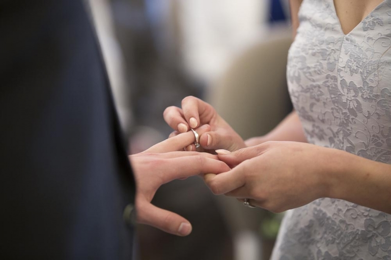 Glasgow City Chambers wedding photographer - exchanging wedding rings hands closeup