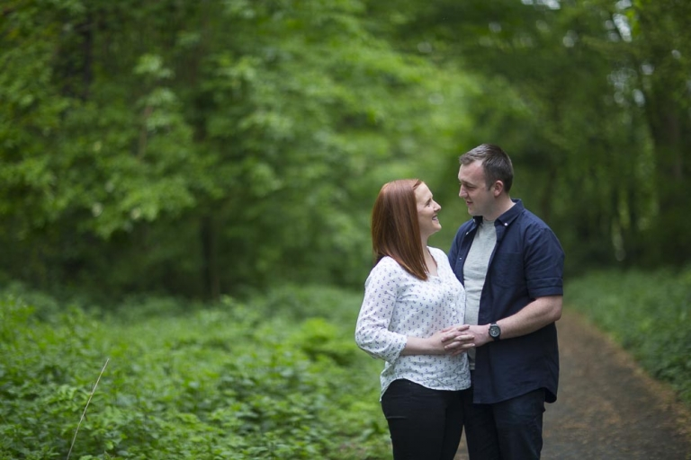 engagement photographer fife , couple in woods