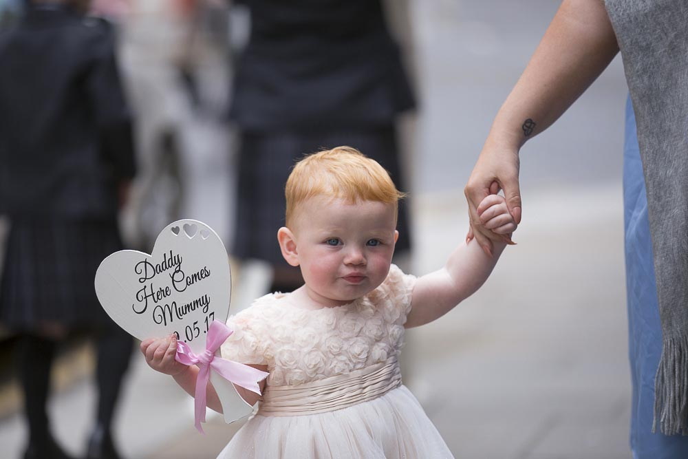 Glasgow City Chambers wedding photography cute flower girl with sign daddy here comes mummy