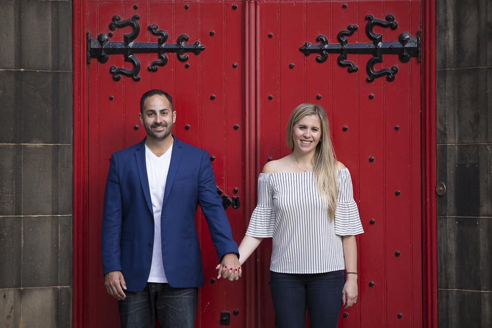 engagement photography Edinburgh couple red door background