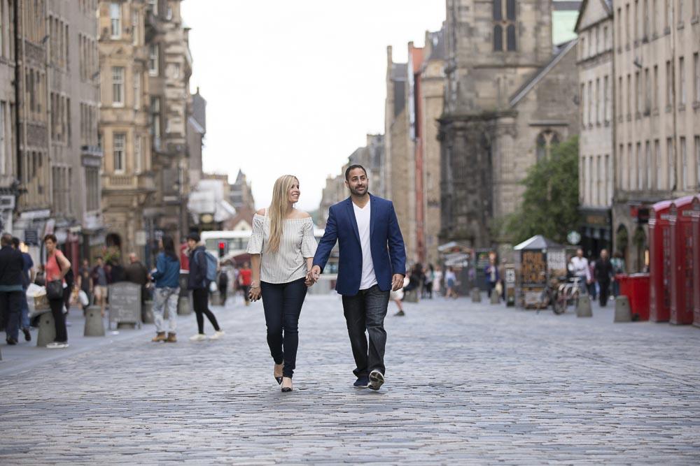 engagement photography Edinburgh couple walking on royal mile