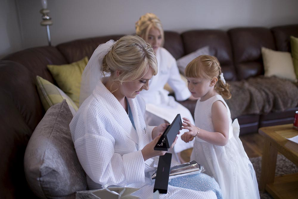 Invercarse Hotel wedding photography dundee - bride opening gift