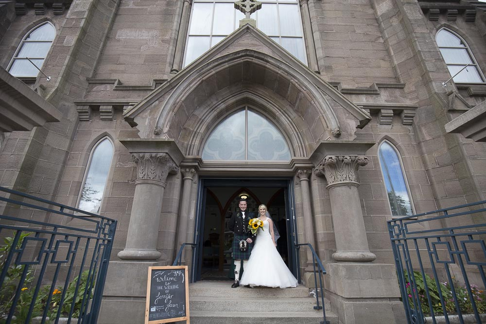 Invercarse Hotel wedding photography dundee 024 - bride and groom in front os st andrews church arbroath