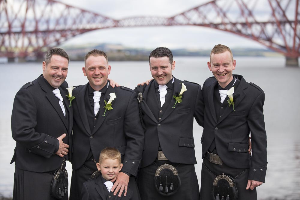 orocco pier wedding photography groom with best man and ushers