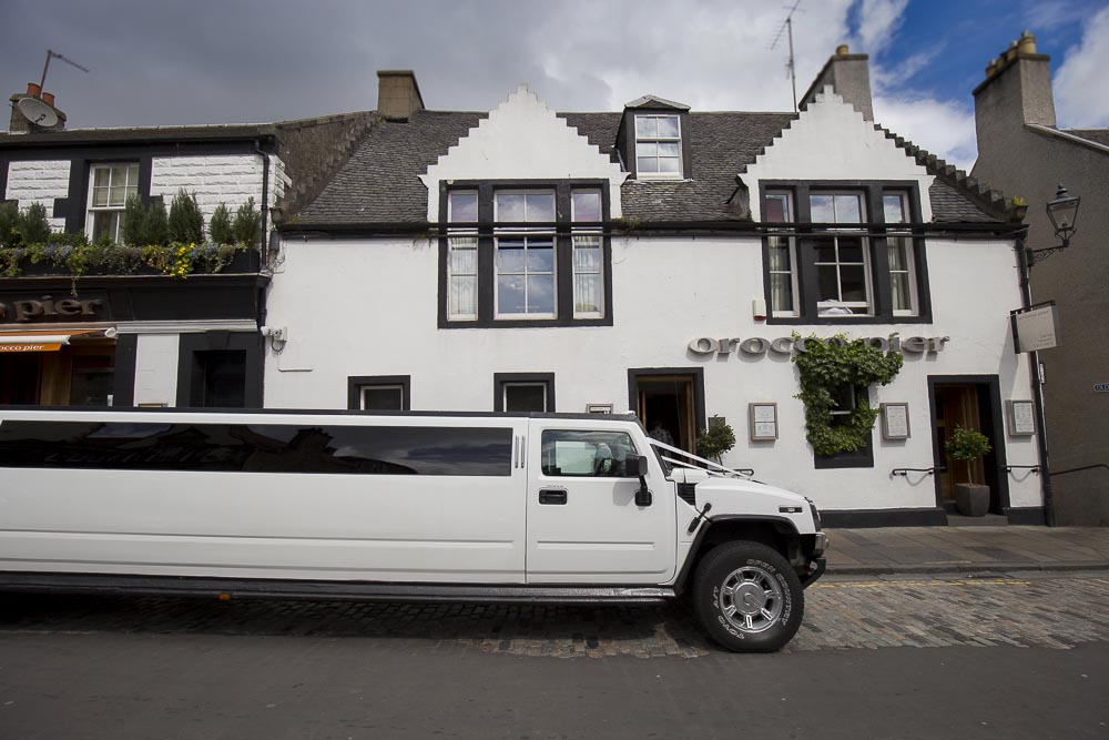 orocco pier wedding photography limousine hummer in front of venue