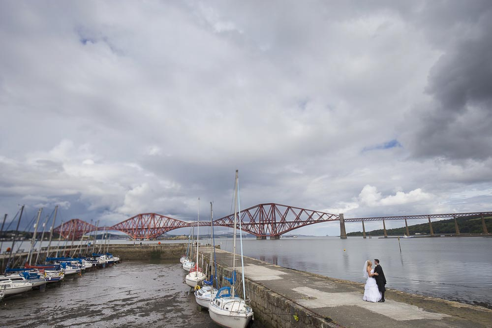 orocco pier wedding photography bride and groom with pier view