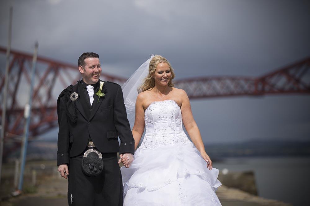 orocco pier wedding photography happy newlywed couple walking on pier