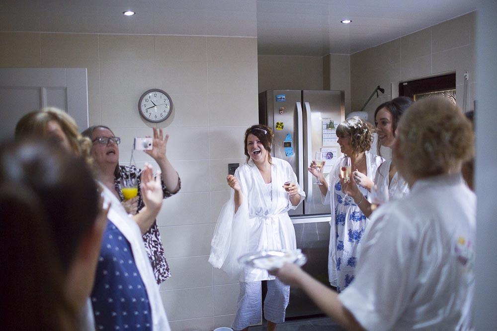 dunblane hydro wedding photography bride and bridesmaids having fun