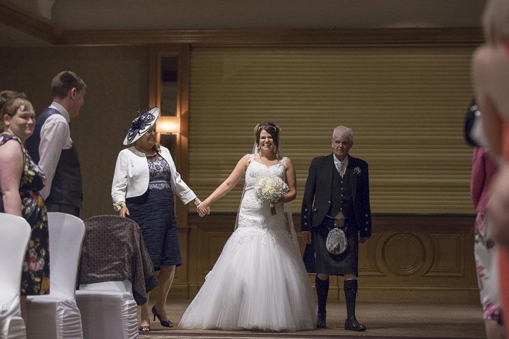 dunblane hydro wedding photography bride walking dawn the aisle