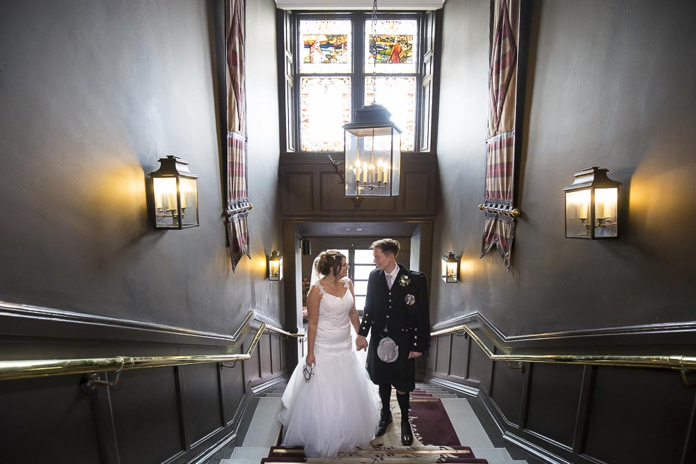 dunblane hydro wedding photography bride and groom on stairs