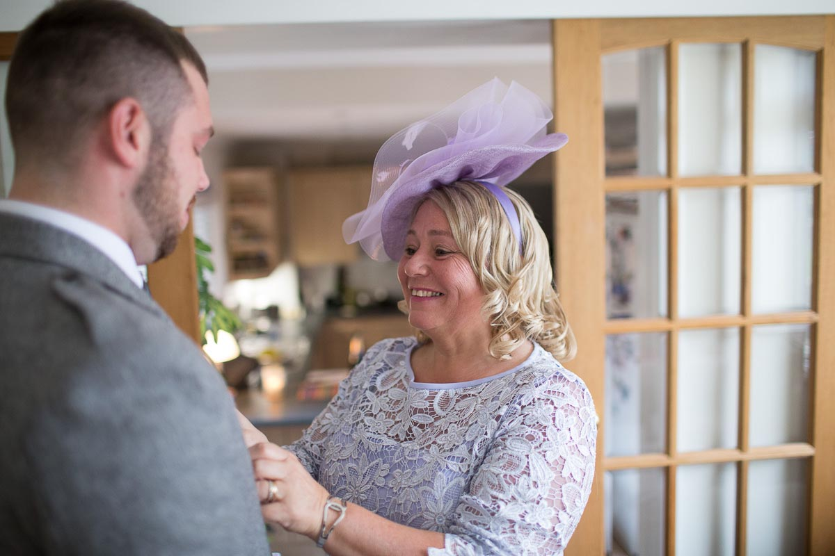 Forrester Park wedding photography mother helps groom