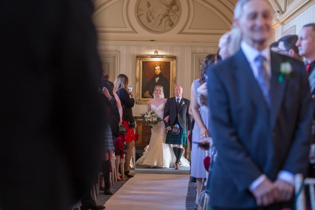 Balbirnie House Wedding Photography bride walking dawn the aisle with her father
