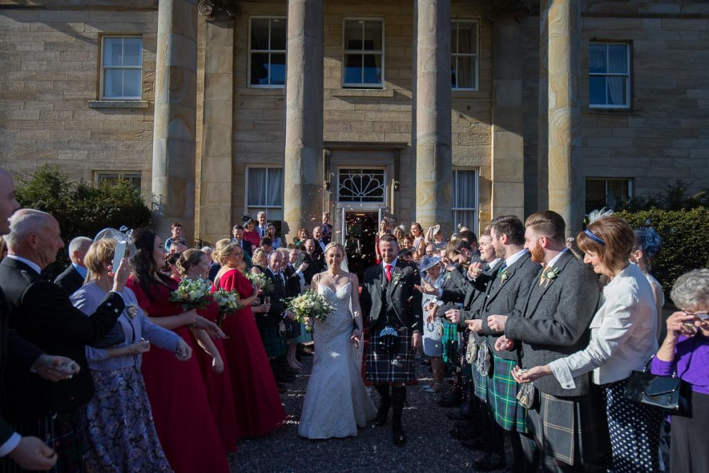 Balbirnie House Wedding Photography confetti in front of the venue
